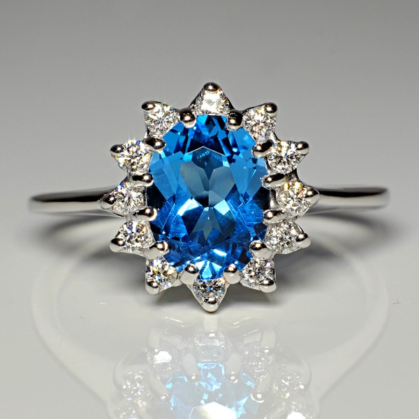 Gold ring with Swiss Blue Topaz and Diamonds i055TpSwDi